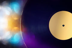 Old records on wooden table with glitter background Royalty Free Stock Image