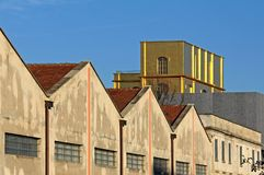 The old gold-lined distillery stands out among the buildings of the Prada Foundation. Old recovered buildings and other modern buildings form the exhibition and royalty free stock photography