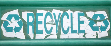 Old recycle sign. The dirty and worn recycling center sign shows the reduce, reuse recycle logo triangle Stock Photo