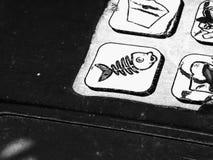 Old recycling sticker on garbage bin. Dead fish logo.