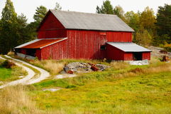 Old red abandoned farm, Norway. An old falling down farm Telemark, Norway. Norwegian oldest wooden grey farm house. Old abandoned norwegian farm house, boarded Stock Photography