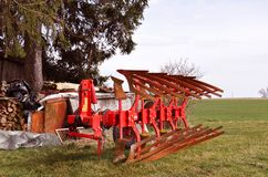 Old red agricultural machine with rust on it, rustic farm equipm Stock Image