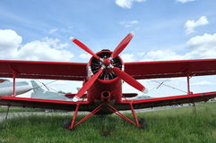 Old red airplane Stock Photos
