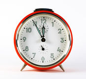 Old red alarm clock. On white background stock images
