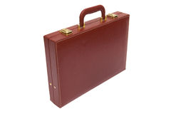 Old red attache case. On a white background royalty free stock photos