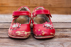 Old red baby shoes Royalty Free Stock Photo