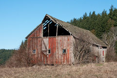 The Old Red Barn. This morning shot of a weathered red barn was taken near Anacortes, Washington Stock Photos