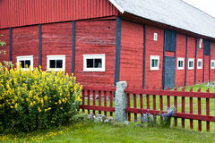 Old red barn. House with a foreground fence Stock Photography