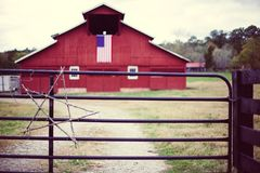 Old Red Barn Black Fence Christmas Star American Flag Stock Photography
