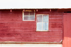 Old Red Barn with Dirty Windows on the Plains of Colorado Royalty Free Stock Photos