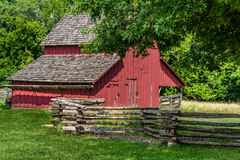 Old Red Barn on a farm. In Missouri Town with old wooden fence Royalty Free Stock Photo