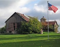 Old Red Barn with Flag Stock Photos