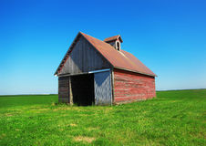 Old Red Barn in Green Field Stock Photography