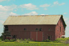 Old red barn with hay still being stored. Stock Photo