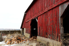 Old Red Barn in Illinois close up. An old red barn with firewood in front Royalty Free Stock Images