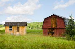 Old Red Barn. The side of an old red barn with closed door and hay loft, and weathered tin roof Stock Photography
