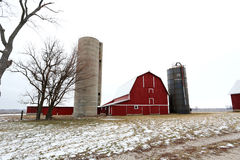 Old Red Barn and Silos in Winter in Illinois. An old red barn and silos in the snow in Illinois Royalty Free Stock Photo