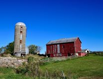 Old Red Barn in Stephenson County. This is a Fall picture of a family farm featuring an old red barn, a concrete silo, and an animal coral located in Stephenson royalty free stock image