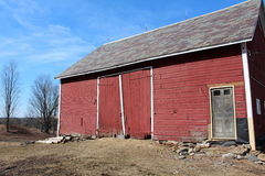 Old red barn with weathered doors Royalty Free Stock Photography