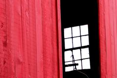 The old red barn,. This old red barn with the windows in the background made for an interesting scene. This image is a perfect cover for a mystery novel Stock Images