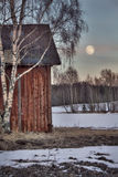 Old red barn in wintry landscape Royalty Free Stock Photography