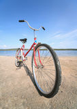 Old red bicycle photographed on beach Royalty Free Stock Photo
