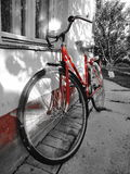Old red bicycle. Photography of red old bicycle in backyard Royalty Free Stock Photo