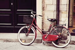Old red bicycle Stock Images