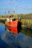 Old red boat in Howth Harbor, Dublin, Ireland. Howth, Dublin, Ireland - old red fishing boat Royalty Free Stock Photo