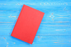 Old red book on wooden plank background. Blank empty cover for d. Top view old red book on wooden plank background. Blank empty cover for design Royalty Free Stock Images