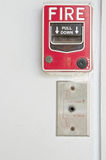Old red box of fire alarm on white wall background Stock Image