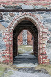 An old red brick archway. An old red brick and stone archway Stock Images