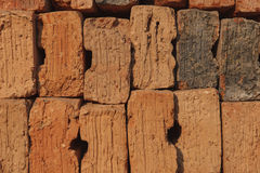 Old red brick arranged in a row Stock Photos