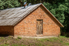 Old red brick barn. In remote village Stock Images