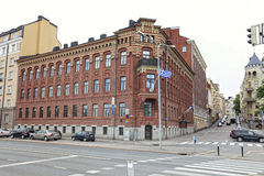 The old red brick building built in 1884 with the flag of Finland royalty free stock photography