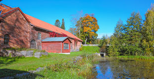 Old red brick building over pond Stock Image