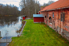 Old red brick building over pond Stock Photography