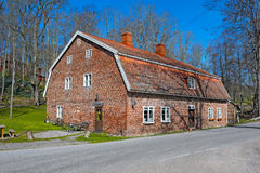 Old red brick building with a red tile roof Royalty Free Stock Photo