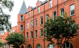 Old Red Brick Building with Turret Windows Stock Image