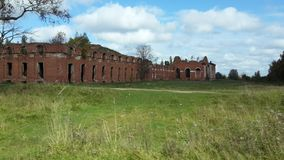 Old red brick buildings in the forest stock image