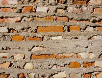 Old red brick and concrete wall background Stock Image