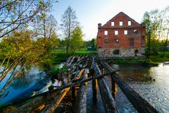 Old red brick construction near river in the countryside royalty free stock image