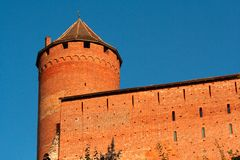 Old red brick fortress. Tower on blue sky background Royalty Free Stock Photography