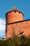 Old red brick fortress  tower. On blue sky background Royalty Free Stock Photo