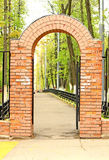 The old red brick gate. And a road Royalty Free Stock Photography