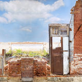 Old red brick house fragment with a wooden door Stock Photography