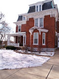 Old red brick house in winter Stock Photography
