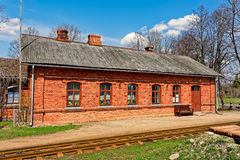 Old red brick railway station building Stock Image
