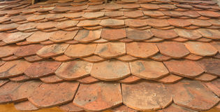 Old red brick roof tiles from north east of thailand. Usually this kind of tiles is used to build the roof of the temple Stock Images