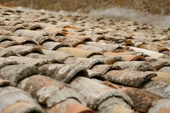 Old red-brick roof tiles. Sun-drenched Royalty Free Stock Image